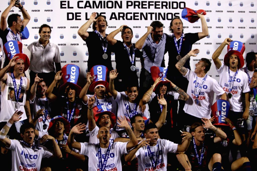 Players of San Lorenzo celebrate winning the championship of the 2013 Argentinian Soccer Tournament, after the match against Velez Sarsfield, held in the .