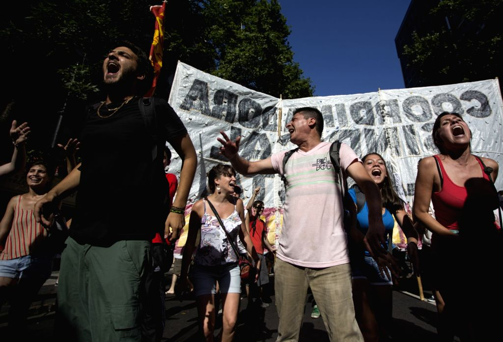 Members of the Argentine Workers' Central Union (CTA), and other social organizations and leftist parties, shout slogans in Buenos Aires city, ...