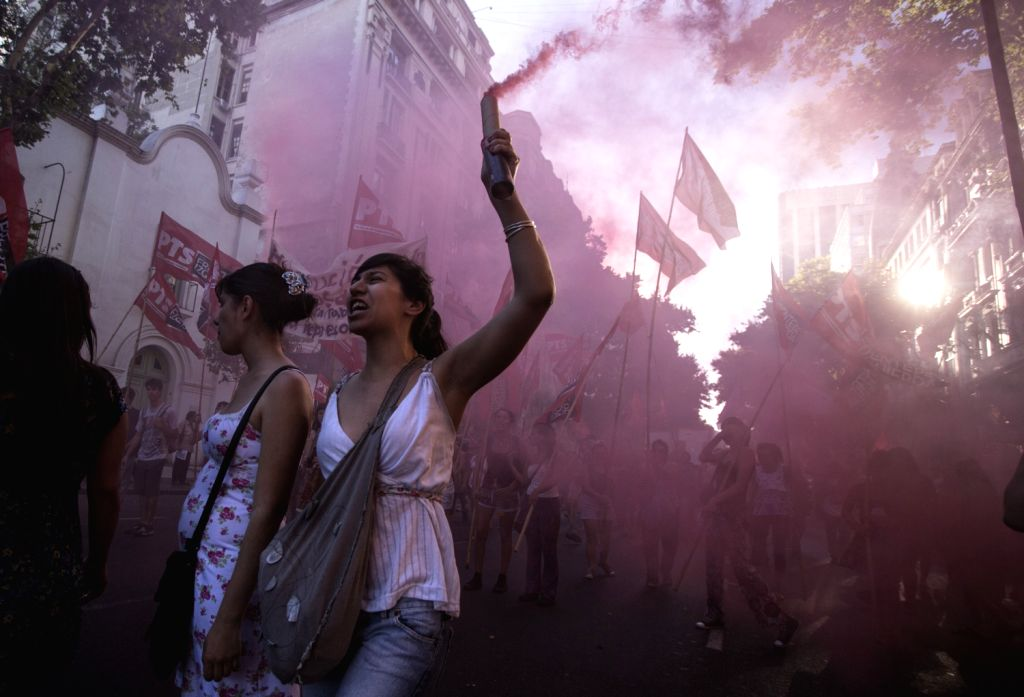 """Demonstrators participate in a march to commemorate the 12th anniversary of the people's rebellion of 2001, known as the """"Argentinazo"""", in ."""