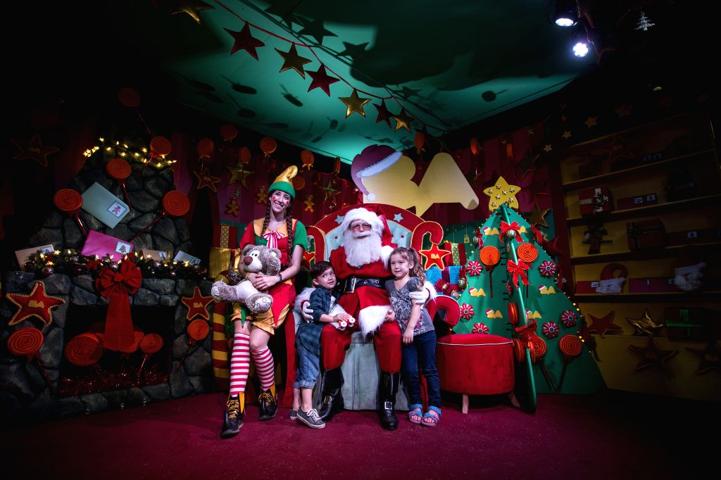Children pose with Santa Claus in the Christmas Park in Buenos Aires City, capital of Argentina, on Dec. 21, 2014.