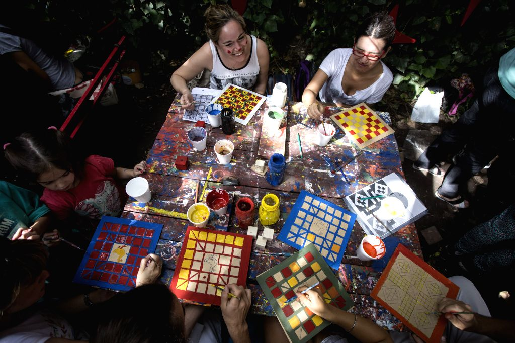 """Volunteers create wooden educational toys that will be donated to children from low-income family in the """"Si"""" Foundation Toy Factory in Buenos Aires ."""
