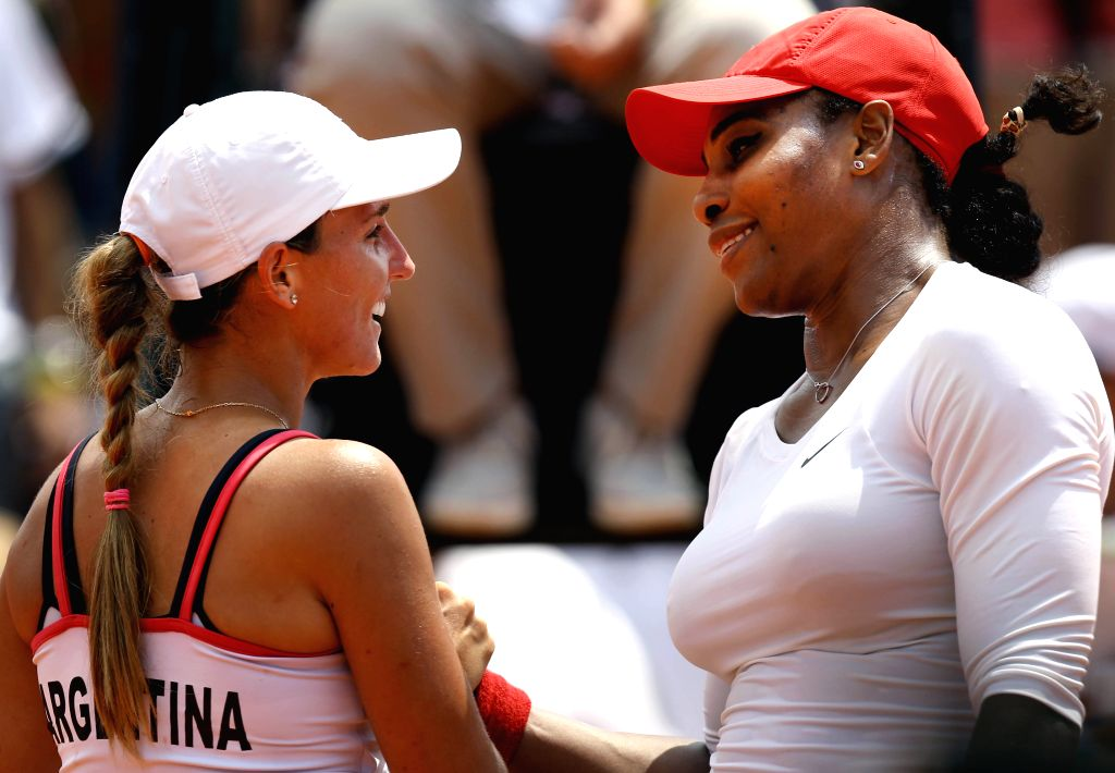 Maria Irigoyen (L) of Argentina shakes hands with Serena Williams of the United States after their women's single match of World Group II during the Federation .