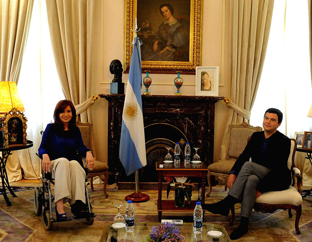 Argentine President Cristina Fernandez (L) meets with French economist Thomas Piketty (R) at the Presidential Residence in Buenos Aires Jan. 17, 2015. ...