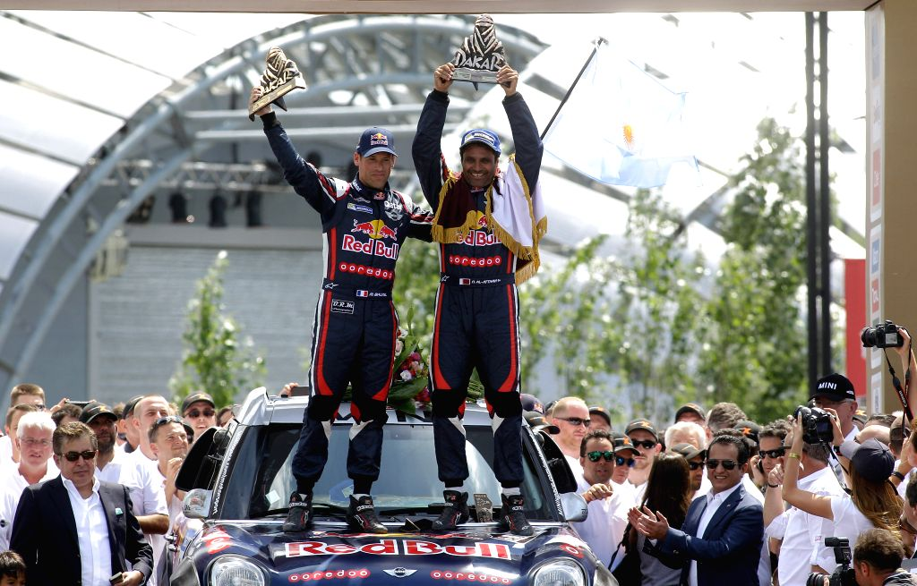 Qatari pilot Nasser Al-Attiyah (R) and his French co-pilot Matthieu Baumel (L) celebrate after winning champion of the cars category in the Dakar Rally 2015 at