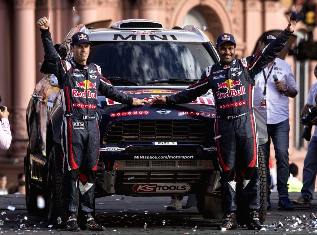 Qatari pilot Nasser Al-Attiyah (R) and his copilot Baumel Matthieu greet spectators during a symbolic start of the 2015 Dakar Rally in Buenos Aires, Argentina, .