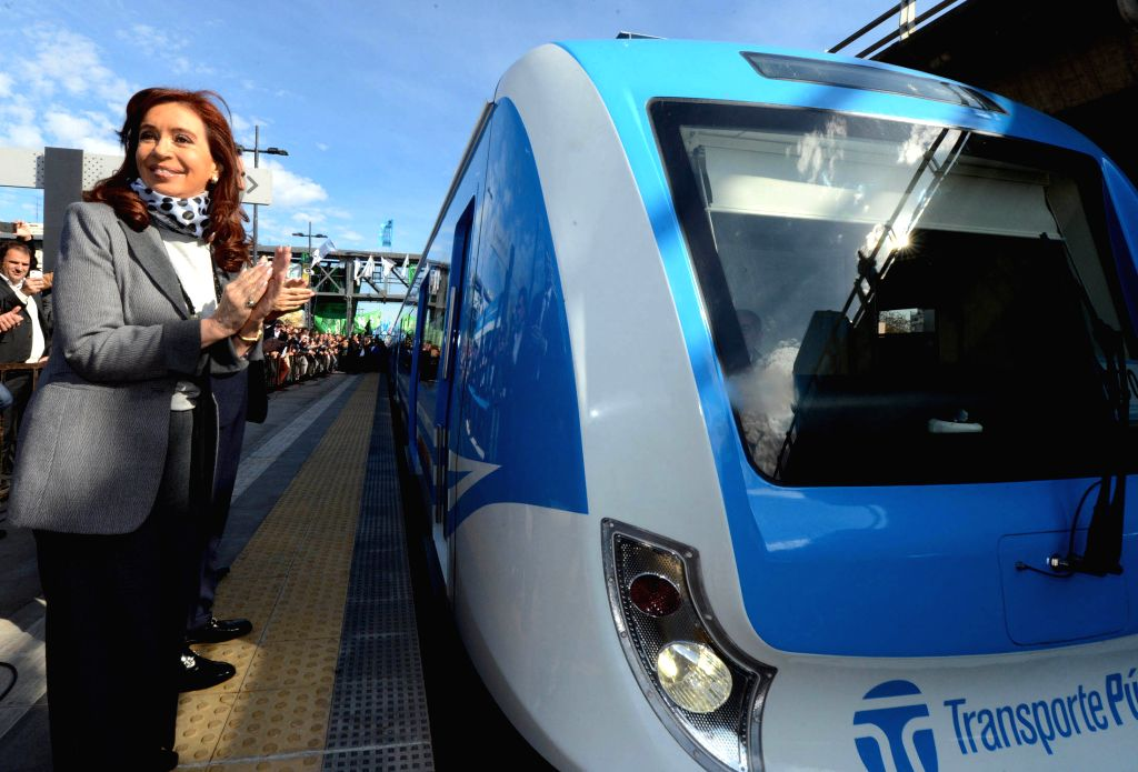 Argentine President Cristina Fernandez(L), reacts during the presentantion of seven units for the Sarmiento Railway, at Villa Luro station, in Buenos Aires, ...