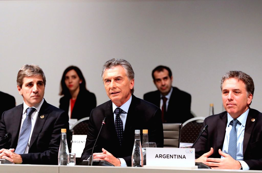 BUENOS AIRES, July 23, 2018 - Argentine President Mauricio Macri (C), Argentine Central Bank President Luis Caputo (L) and Treasury Minister Nicolas Dujovne participate in the Group of 20 (G20) ... - Nicolas Dujovne