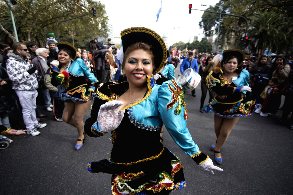 """Women members of the Bolivian community living in Argentina take part in the parade for the celebration of Argentina's Independence Day, in the """"Avenida de"""