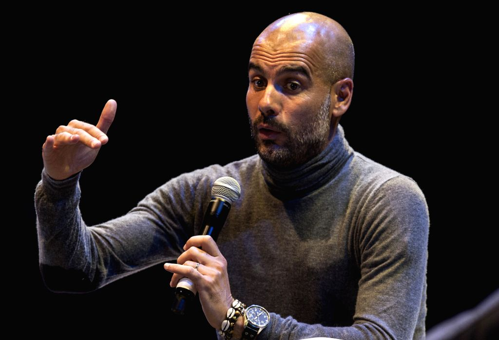 """The Spanish Josep """"Pep"""" Guardiola (L), current coach of the German team Bayern Munich, speaks during the conference """"The FIFA World Cup, ..."""