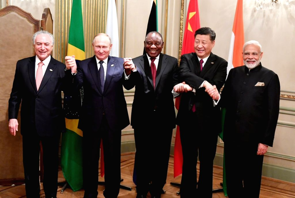 Buenos Aires: Leaders of the BRICS nations - Prime Minister Narendra Modi, Brazilian President Mechel Temer, Chinese president Xi Jinping, Russian President Vladimir Putin and South African President Cyril Maraphosa poses for a group photo on the sid - Narendra Modi