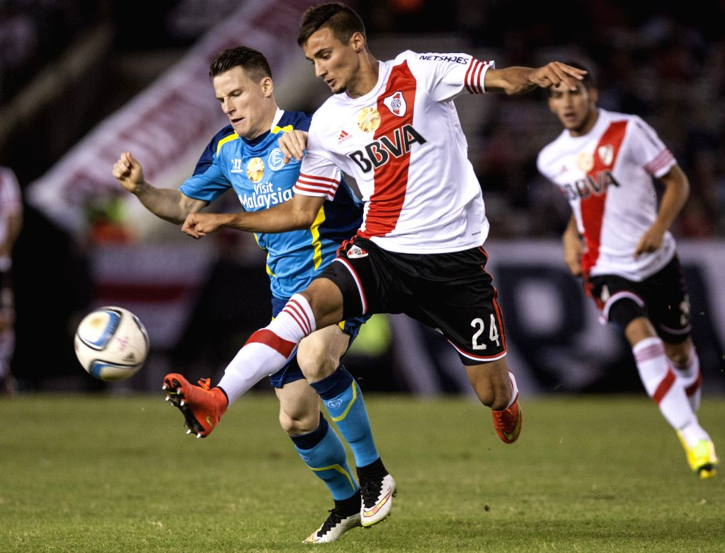River Plate's Emanuel Mammana (R) of Argentina vies for the ball with Sevilla's Kevin Gameiro during the match of Euroamerican Super Cup, held at Antonio ...