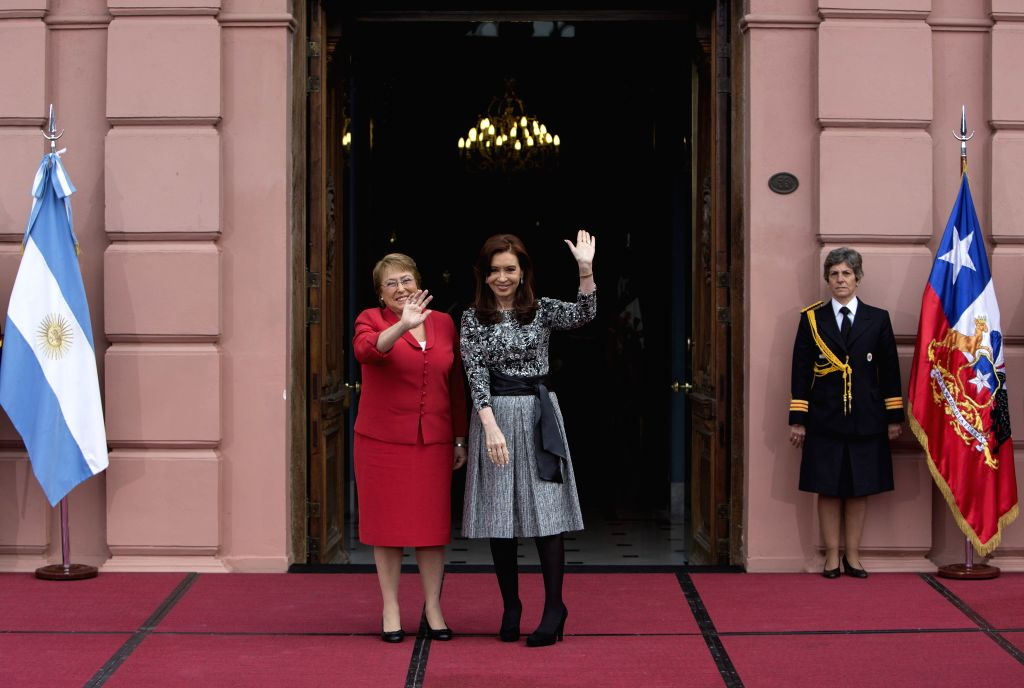 The President of Argentina Cristina Fernandez (front R) poses with his Chilean counterpart Michelle Bachelet (L) in the Presidential House in Buenos Aires, ...