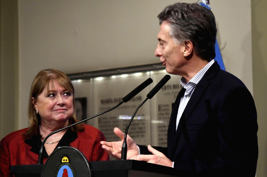 BUENOS AIRES, May 30, 2017 - Argentina's President Mauricio Macri (R) speaks while Foreign Minister Susana Malcorra looks on during a news conference in Buenos Aires May 29, 2017. Mauricio Macri said ... - Susana Malcorra
