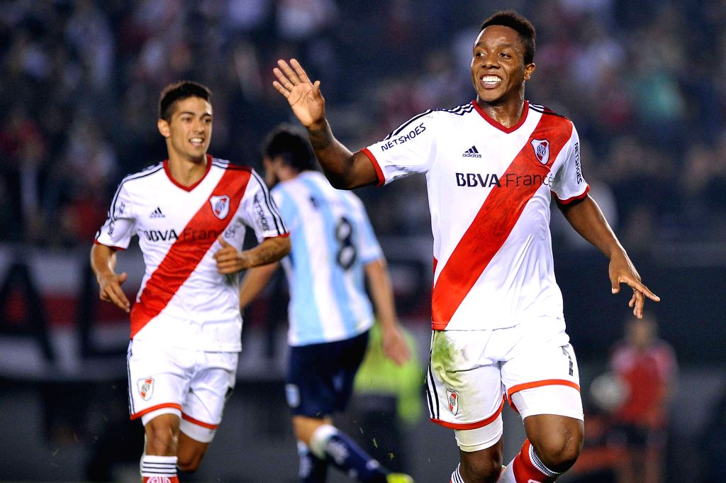 Carlos Carbonero (R) of River Plate celebrates during the match of the Final Tournament against Racing Club in the Monumental Stadium in Buenos Aires, capital of