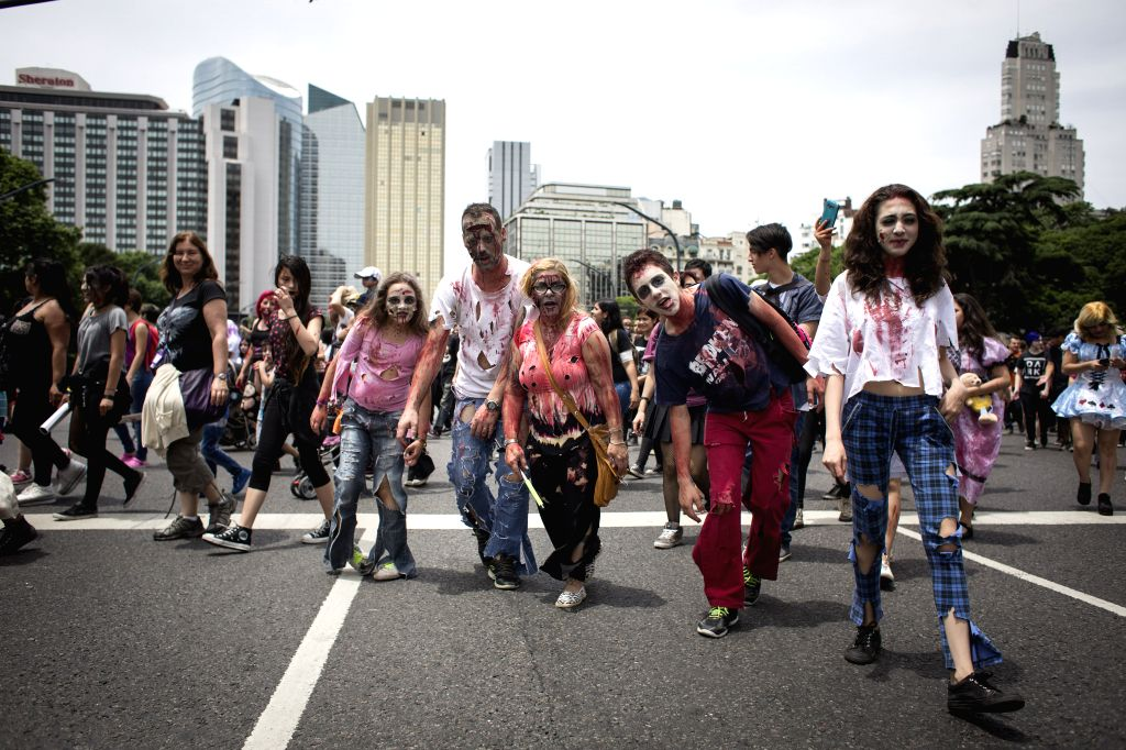 """BUENOS AIRES, Nov. 28, 2016 - People take part in the """"Zombie Walk"""" in Buenos Aires, Argentina, on Nov. 27, 2016. (Xinhua/Martin Zabala)"""
