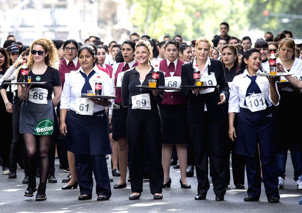 BUENOS AIRES, Oct. 23, 2016 - Competitors prepare to take part in the 13th Waiters and Waitresses Race in Buenos Aires, capital of Argentina, on Oct. 22, 2016. The contest attracted more than 400 ...