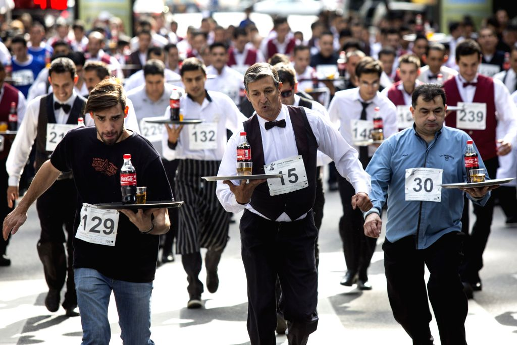 BUENOS AIRES, Oct. 23, 2016 - Competitors take part in the 13th Waiters and Waitresses Race in Buenos Aires, capital of Argentina, on Oct. 22, 2016. The contest attracted more than 400 participants.