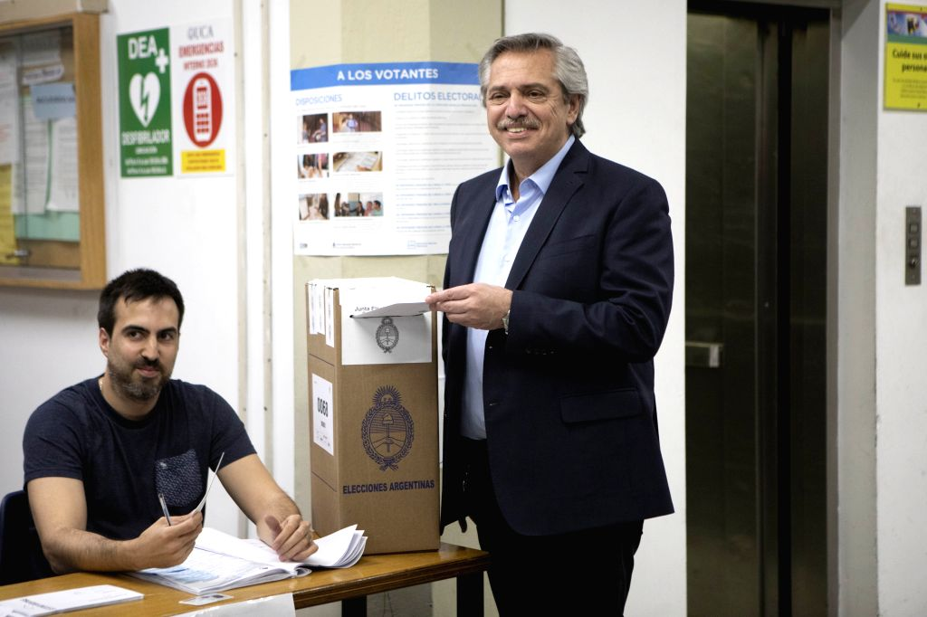 BUENOS AIRES, Oct. 28, 2019 - Alberto Fernandez (R) votes at a polling station in Buenos Aires, Argentina, Oct. 27, 2019. Alberto Fernandez, of the opposition Everyone's Front coalition, obtained ...