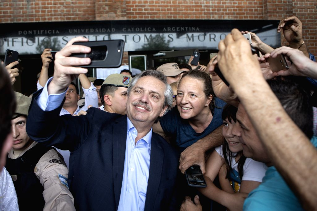 BUENOS AIRES, Oct. 28, 2019 - Alberto Fernandez takes a selfie with supporters at a polling station in Buenos Aires, Argentina, Oct. 27, 2019. Alberto Fernandez, of the opposition Everyone's Front ...