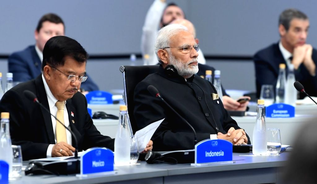 Buenos Aires: Prime Minister Narendra Modi at the 1st session of 13th G20 Summit on Global Economy in Buenos Aires, Argentina on Nov 30, 2018. - Narendra Modi