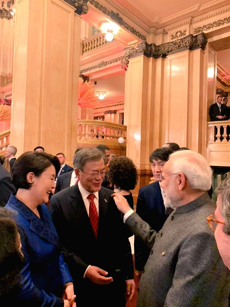 Buenos Aires: Prime Minister Narendra Modi during an interaction with Moon Jae-in and his wife Kim Jung-sook ahead of the cultural performance and dinner hosted by Argentinian President Mauricio ... - Narendra Modi