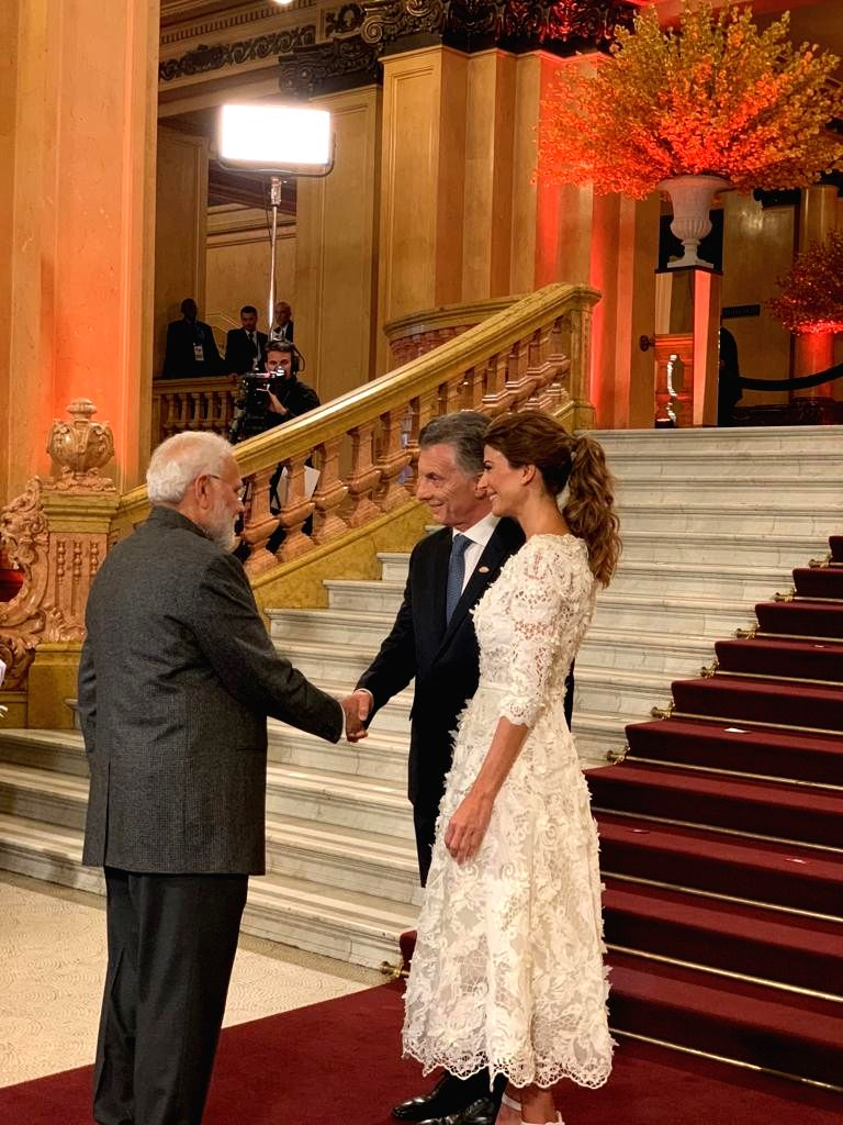 Buenos Aires: Prime Minister Narendra Modi during an interaction with Argentinian President Mauricio Macri and his wife Juliana Awada ahead of the cultural performance and dinner hosted by the ... - Narendra Modi