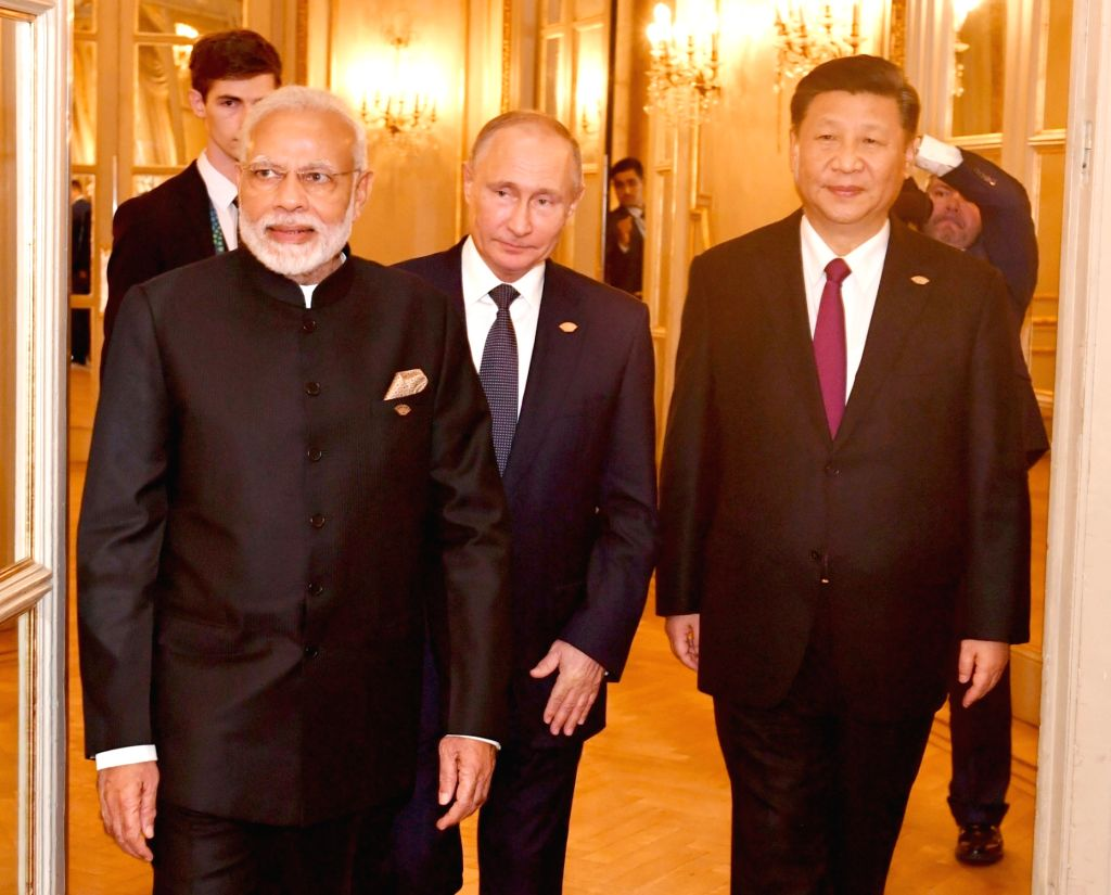 Buenos Aires: Prime Minister Narendra Modi, Russian President Vladimir Putin and Chinese President Xi Jinping at the RIC (Russia, India, China) Informal Summit, in Buenos Aires, Argentina  on Nov 30, 2018. (Photo: IANS/PIB) - Narendra Modi