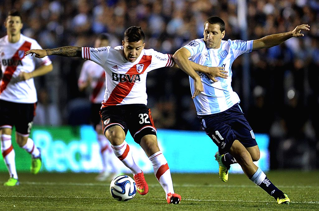 Buenos Aires: Racing's Luciano Aued (R) vies with Sebastian Driussi of River Plate during a match, in Buenos Aires, Argentina, on Nov. 23, 2014.