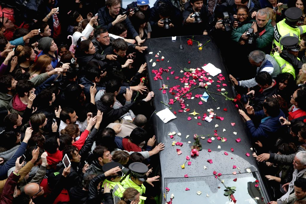 Residents bid farewell to the body of Gustavo Cerati, at the end of the funeral of the Argentinian musician, in the Legislature of Buenos Aires city, capital ..