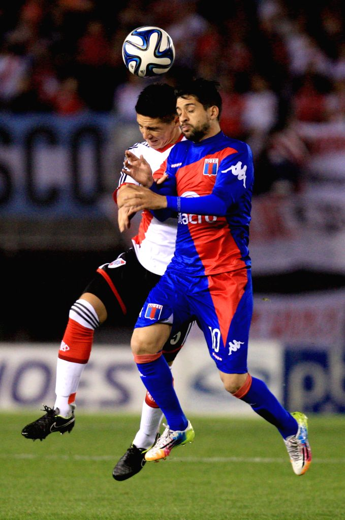 Matias Kraneviter (L) of River Plate vies for the ball with Lucas Wilchez of Tigre during the match of the Argentinean First Division in the Antonio Vespucio ..