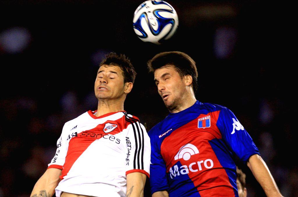 Rodrigo Mora (L) of River Plate vies for the ball with Ignacio Canuto of Tigre during the match of the Argentinean First Division, in the Antonio Vespucio ...