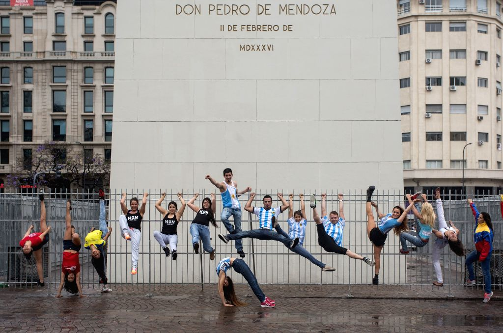 Buenos Ares: Competitors of the Argentina and South America Pole Championship 2014 show their pole dance skills at the base of the Obelisk in Buenos Ares, Argentina, on Nov. 21, 2014. Around 100 pole