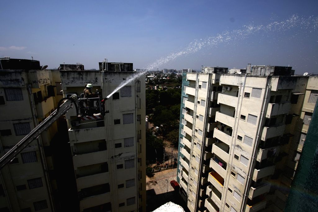 Buildings in a residential area being sanitised on Day 7 of the 21-day nationwide lockdown imposed to contain the spread of COVID-19 (coronavirus) in Chennai on March 31, 2020.