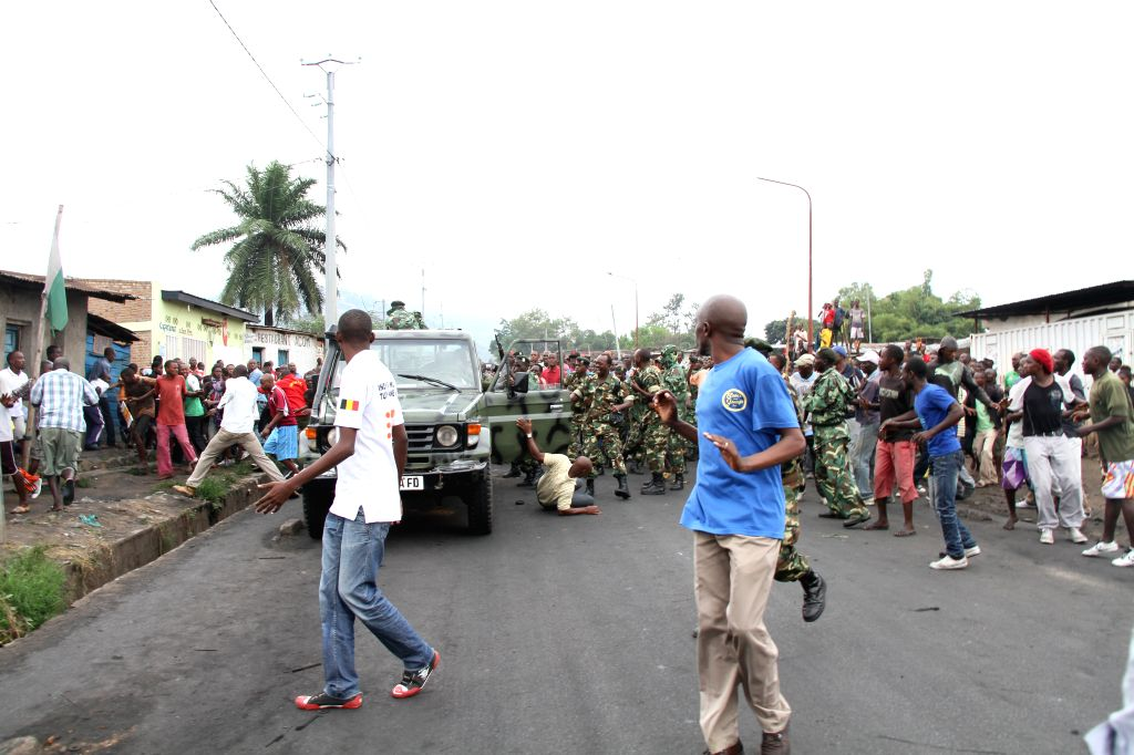 Brundian soldiers clash with protesters during a demonstration against the third term of Burundian President Pierre Nkurunziza in Bujumbura, Burundi, April 30, ...