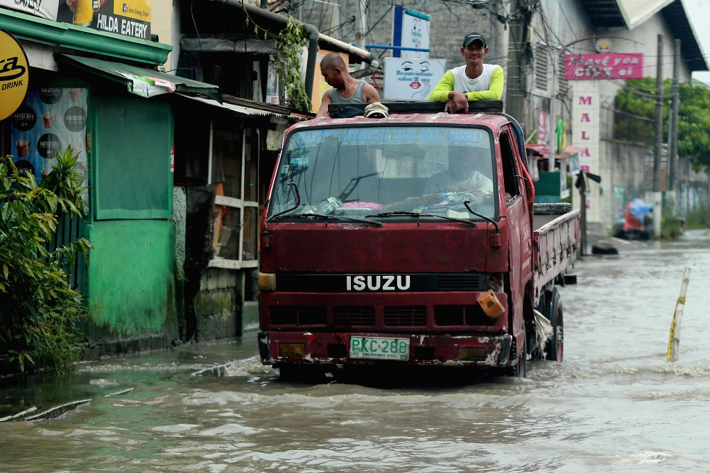 BULACAN, July 20, 2018 - A truck moves through flood after heavy rain brought by tropical storm Ampil in Bulacan Province, the Philippines, July 20, 2018.