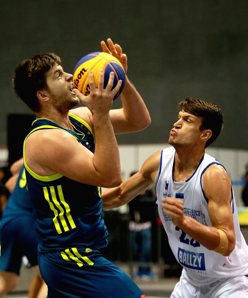 BULACAN, June 10, 2018 - Anze Srebovt (L) of Slovenia shoots the ball against Martin Dorbek of Estonia during the men's Pool B match in the FIBA 3x3 World Cup in Bulacan Province, the Philippines, ...