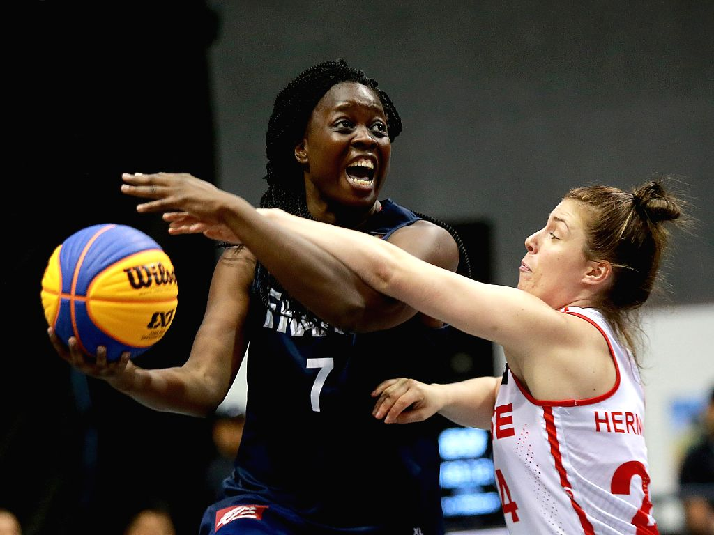 BULACAN, June 10, 2018 - Christelle Diallo (L) of France competes against Evita Herminjard of Switzerland during the women's Pool B match in the FIBA 3x3 World Cup in Bulacan Province, the ...