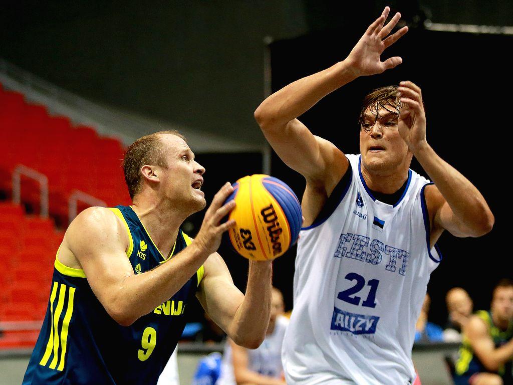 BULACAN, June 10, 2018 - Gasper Ovnik (L) of Slovenia shoots the ball against Malik-kalev Kotsar of Estonia during the men's Pool B match in the FIBA 3x3 World Cup in Bulacan Province, the ... - Malik
