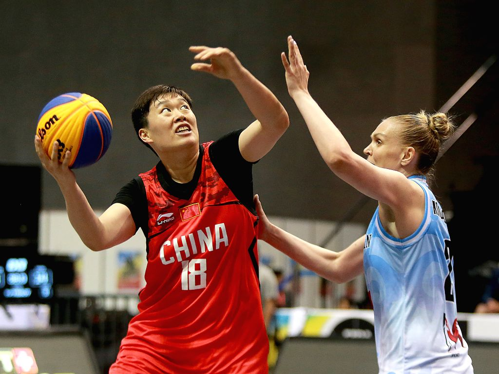 BULACAN, June 10, 2018 - Zhang Zhiting (L) of China shoots the ball against Nadezhda Kondrakova of Kazakhstan during the women's Pool B match in the FIBA 3x3 World Cup in Bulacan Province, the ...