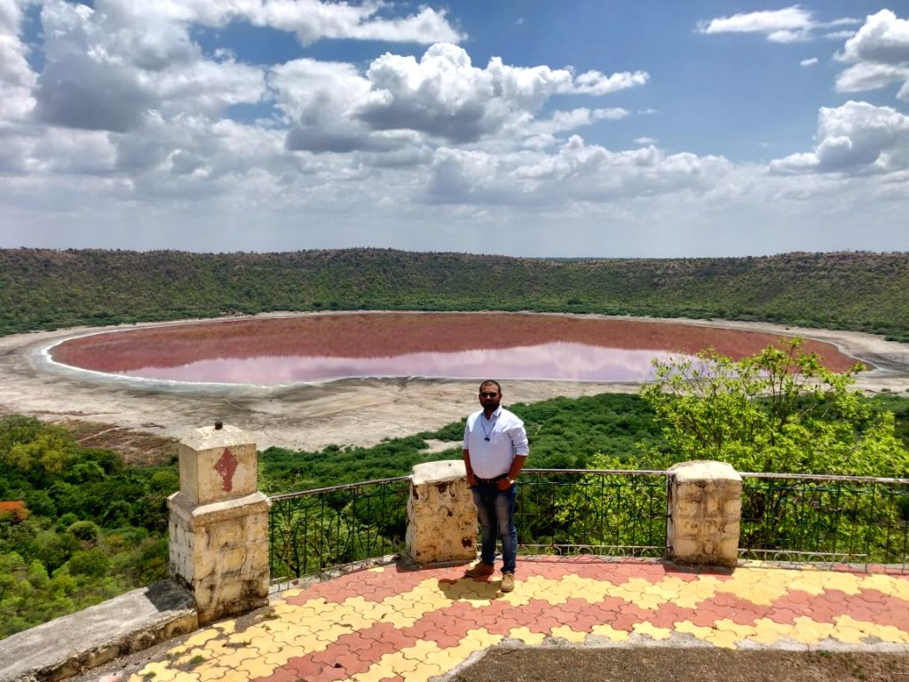 Buldhana: The world famous Lonar Lake, formed by a high velocity impact of a celestial body around 57,000 years ago, has changed colours from bluish-green to a bright baby-pink shade, astounding all, says Buldhana Tehsildar Saipan Nadaf. (Photo: IANS