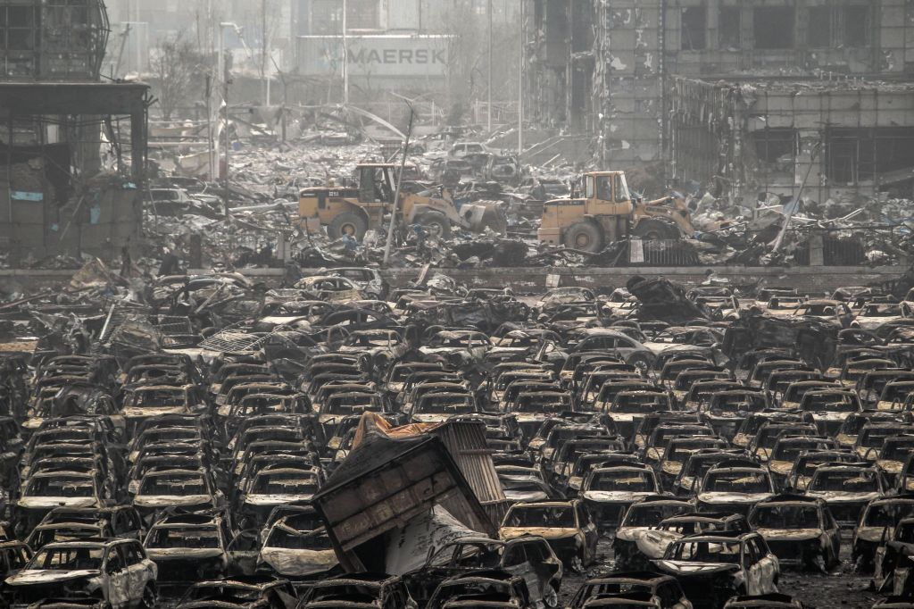 Bulldozers clear off wreckage at the warehouse explostion site in Tianjin, north China, Aug. 17, 2015. Death toll of the massive Tianjin blasts rose to 114 after ...