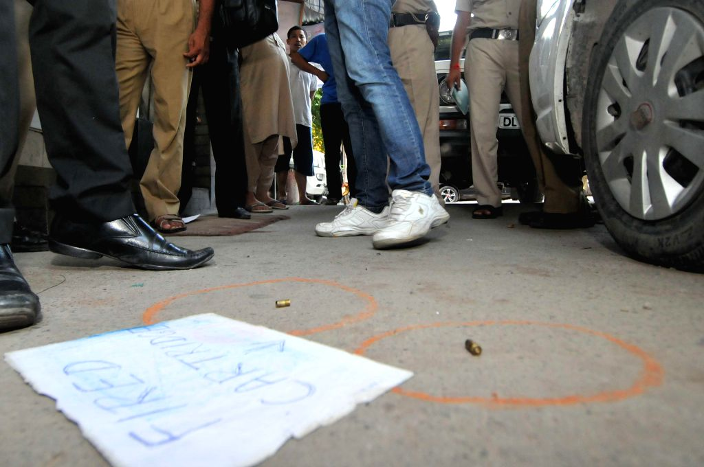 Bullets that were fired at Delhi BJP legislator Jitender Singh Shunty outside his Shahdara home by an assailant lay on the the road in New Delhi on Sept 3, 2014. - Jitender Singh Shunty