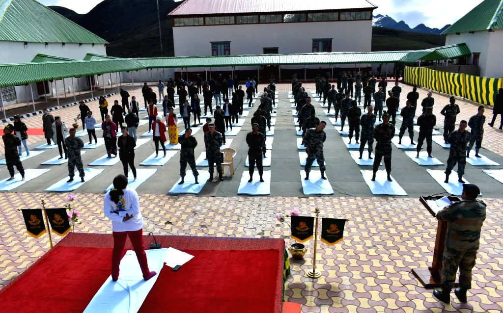 Bumla: Soldiers of Chinese People's Liberation Army and the Indian Army practice yoga asanas - postures - during joint Yoga session organised on 5th International Yoga Day at Bumla in Arunachal Pradesh, on June 21, 2019. Around seventy personnel belo