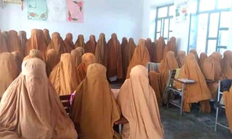 Burqa-clad women.