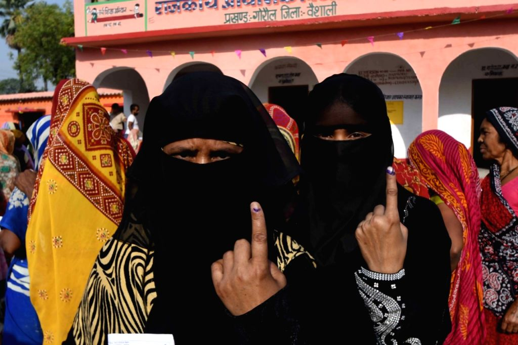 Burqa clad women show their forefingers marked with indelible ink after casting vote during the sixth phase of 2019 Lok Sabha elections, in Vaishali, Bihar on May 12, 2019.