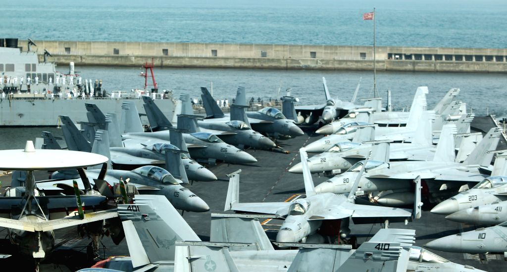 Fighter jets are seen on the flight deck of US nuclear powered aircraft carrier USS George Washington at a naval port in the southeastern port city of Busan, South ...