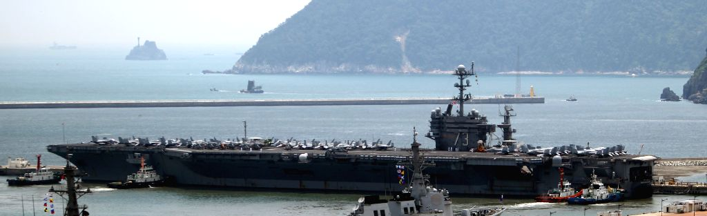US nuclear powered aircraft carrier USS George Washington is seen at a naval port in the southeastern port city of Busan, South Korea, July 11, 2014. The U.S. Navy's .