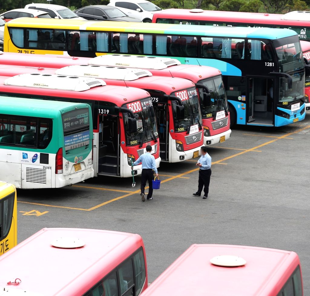 Buses are parked at a garage in Yongin, south of Seoul, on May 13, 2019, two days ahead of a planned strike by some 35,000 unionized bus drivers nationwide, who demand pay hikes and manpower ...