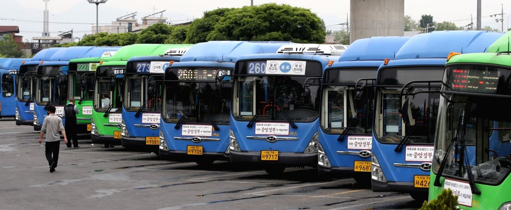 Buses are parked at a public garage in Seoul on May 13, 2019, two days ahead of a planned strike by some 35,000 unionized bus drivers nationwide, who demand pay hikes and manpower increases in ...