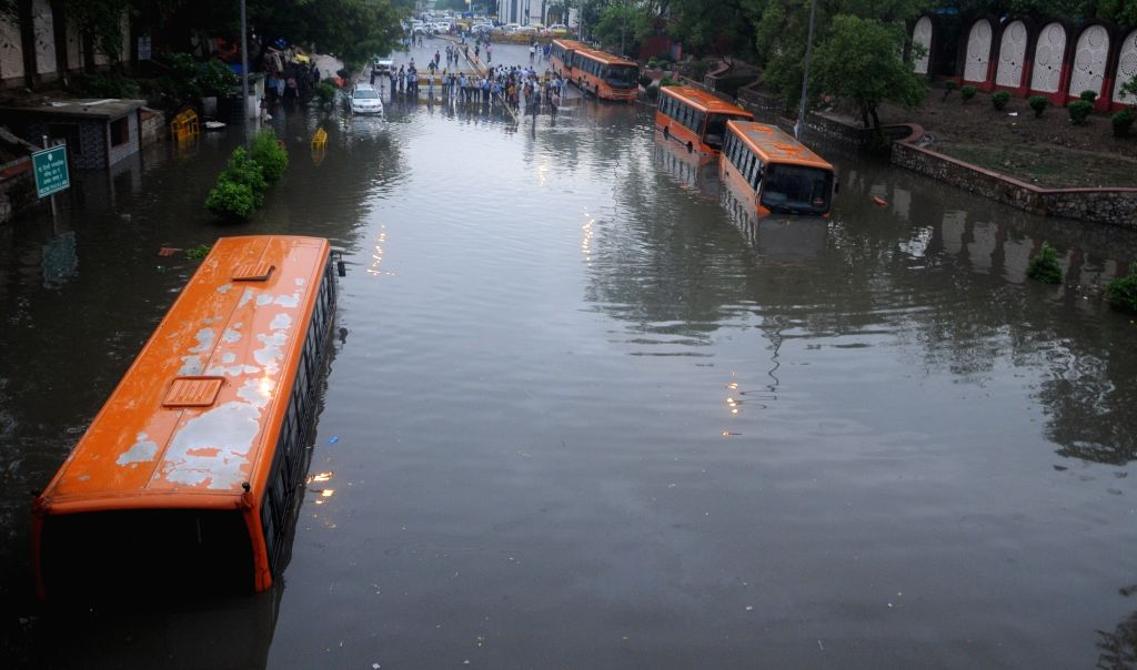 Buses get partially submerged under Delhi's Minto bridge after heavy rains lashed the national capital on July 13, 2018.